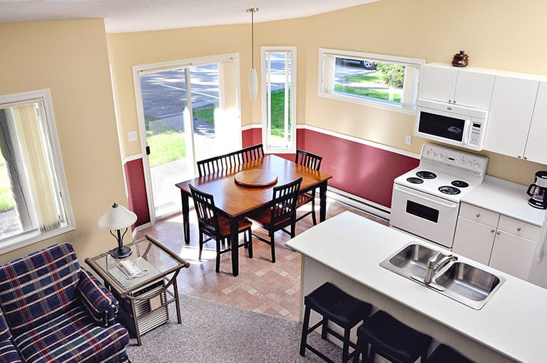 Kitchen and dining area in condo at Ocean Trails Resort